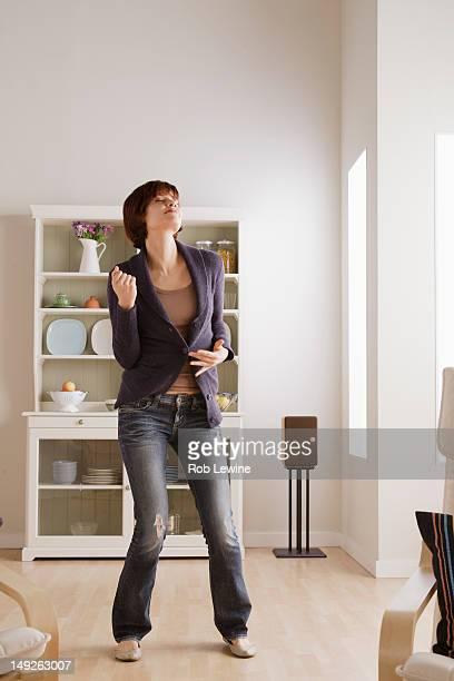 USA, California, Los Angeles, Young woman dancing at home