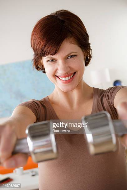 USA, California, Los Angeles, Young woman training at home