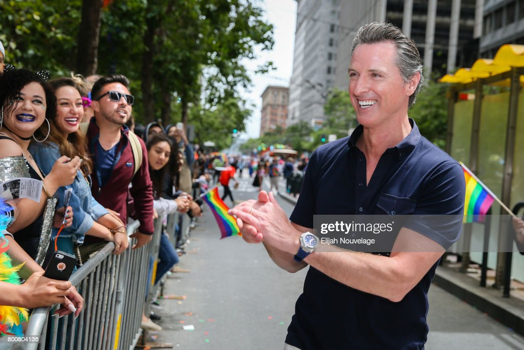 California Lt. Governor Gavin Newsom interacts with fans while marching in the annual LGBTQI Pride Parade on June 25, 2017 in San Francisco, California.