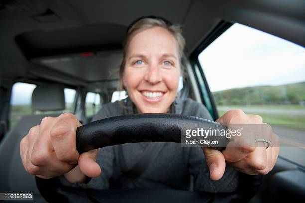 USA, California, Mid adult woman driving
