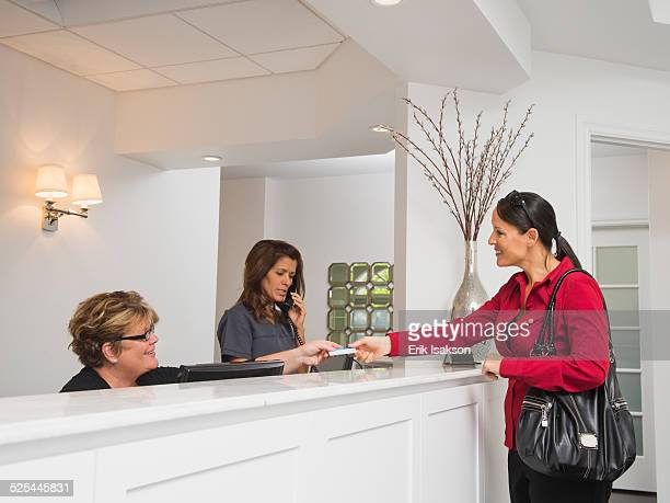 USA, California, Mission Viejo, Female patient at doctor's office front desk