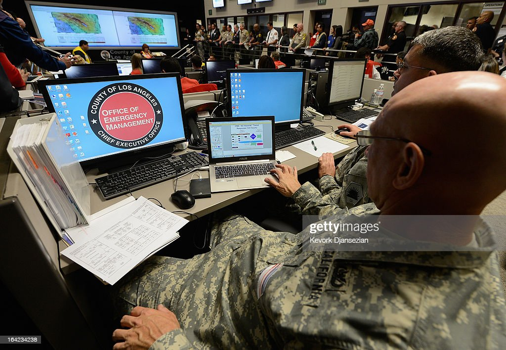 California National Guard Chief Warrent officer Brad Cochran looks at his computer screen after a simulated magnitude 7.0 aftershock following a simulated 7.8 magnitude earthquake during a functional exercise at the Los Angeles County Emergency Operations Center (CEOC) hosted by The County of Los Angeles Office of Emergency Management on March 21, 2013 in Los Angeles, California. The training exercise featured the California Integrated Seismic Network's Earthquake Ready Warning Demonstration System, which included 88 cities, 137 unincorporated communities, 200 schools and several nonprofit organizations.