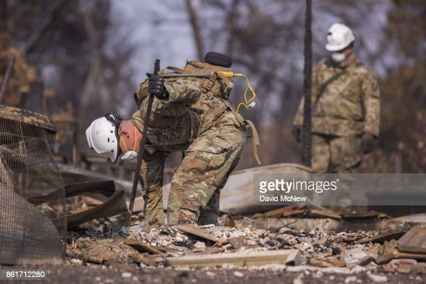 California National Guard troops search burned homes near Mark West Springs Road and Old Redwood Highway on October 15 2017 in Santa Rosa California...