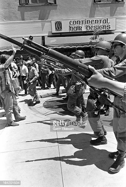 California National Guardsmen bayonets at the ready block the street during protests near People's Park on the campus of the University of Berkeley...