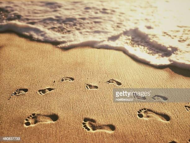 USA, California, Orange, Laguna Beach, Footprints on sand