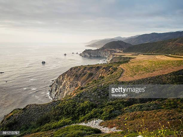 USA, California, Pacific Coast, National Scenic Byway, Big Sur, Coastline with Bixby Bridge at sunset