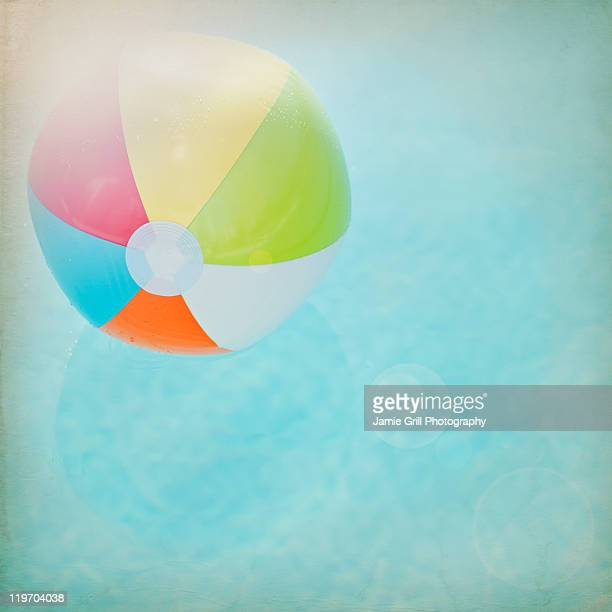 USA, California, Palm Springs, Coachella Valley, San Gorgonio Pass, Close up of striped beach ball against water surface
