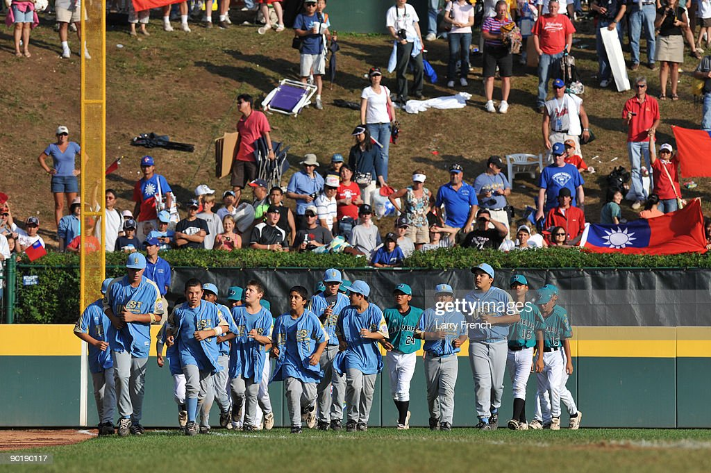 California (Chula Vista) players celebrate their victory against Asia Pacific (Taoyuan, Taiwan) while running around the field after the game with Asia Pacific players after the little league world series final at Lamade Stadium on August 30, 2009 in Williamsport, Pennsylvania.