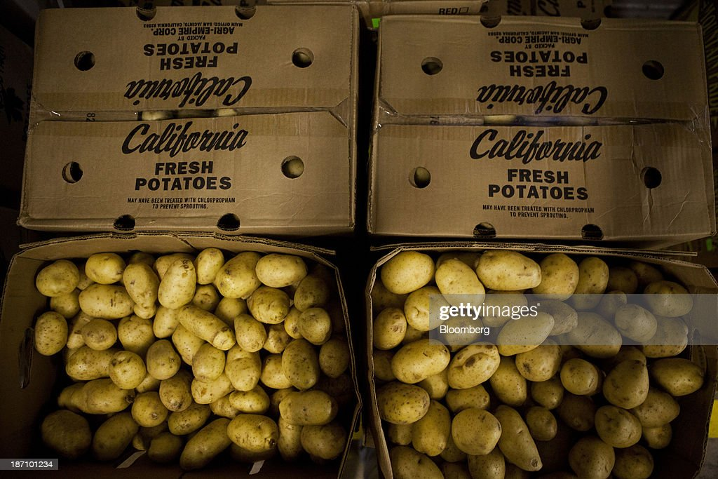 California potatoes sit in crates at the Specialty Produce warehouse in San Diego, California, U.S., on Friday, Nov. 1, 2013. The U.S. Bureau of Economic Analysis is scheduled to release gross domestic product (GDP) figures on Nov. 7. Photographer: Sam Hodgson/Bloomberg via Getty Images