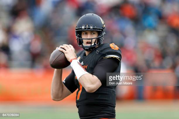 California Quarterback Davis Webb of the South Team warms up on the sidelines before the start of the 2017 Resse's Senior Bowl at LaddPeebles Stadium...