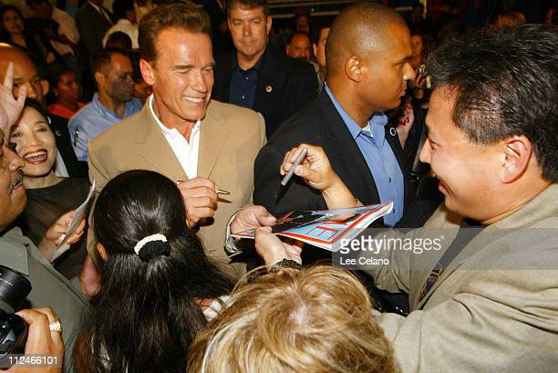 California Republican gubernatorial candidate Arnold Schwarzenegger signs a 'Time' magazine cover for a supporter after appearing at an immigrantonly...