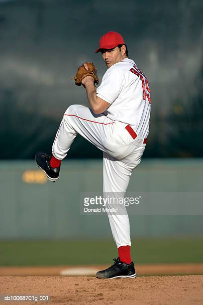 USA, California, San Bernardino, baseball pitcher preparing to throw, outdoors