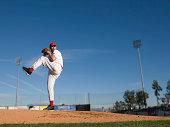 USA, California, San Bernardino, baseball pitcher throwing pitch, outdoors