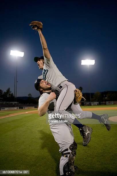 USA, California, San Bernardino, baseball players celebrating victory