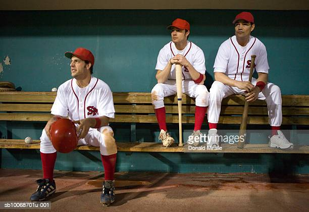 USA, California, San Bernardino, baseball players sitting in dugout
