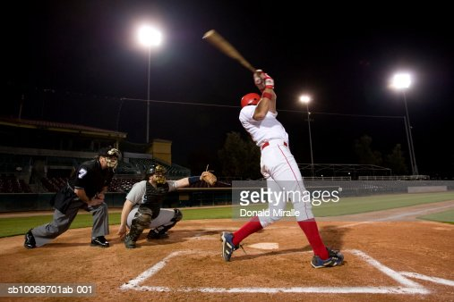 USA, California, San Bernardino, baseball players with batter swinging