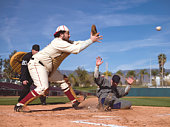 USA, California, San Bernardino, retro-style baseball players, with runner sliding for home base