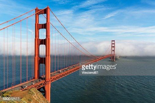 USA, California, San Francisco, Golden Gate Bridge seen from Hawk Hill with fog hiding city