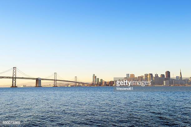 USA, California, San Francisco, Oakland Bay Bridge and skyline of Financial District in morning light