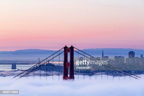USA, California, San Francisco, skyline and Golden Gate Bridge in fog seen from Hawk Hill