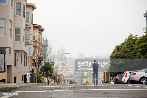 USA, California, San Francisco, woman on street taking a picture