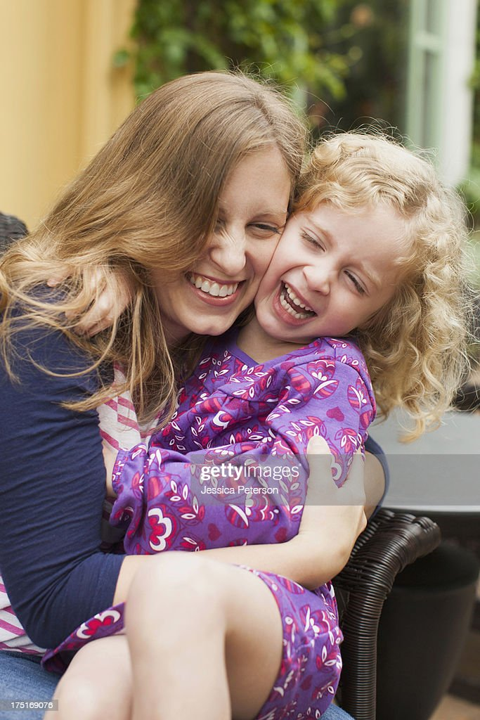 USA, California, San Juan Capistrano, Mother with daughter (2-3) hugging and laughing : Stock Photo