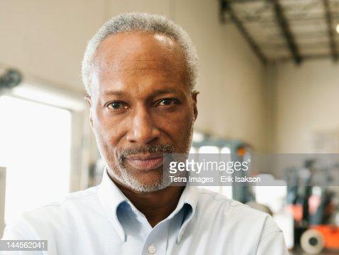 USA, California, Santa Ana, Portrait of businessman in warehouse