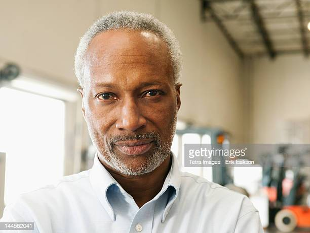 USA, California, Santa Ana, Portrait of businessman in warehouse