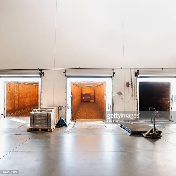 USA, California, Santa Ana, Truck trailers by warehouse