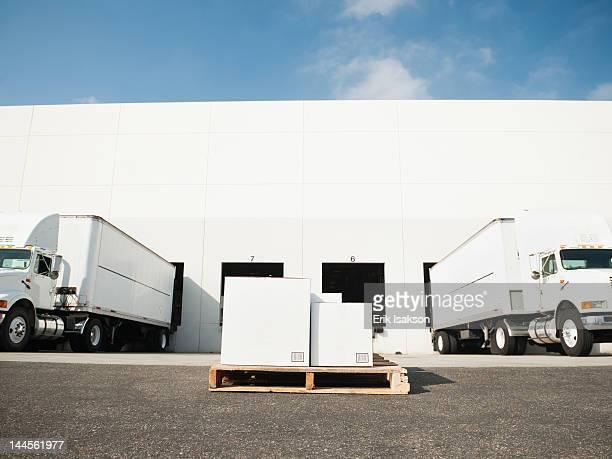 USA, California, Santa Ana, Warehouse with trucks and load