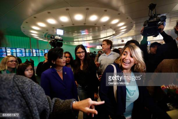 California student Sara Yarjani right is welcomed by her sister Sahar Muranovic in glasses Congresswoman Judy Chu in purple outfit and friends after...