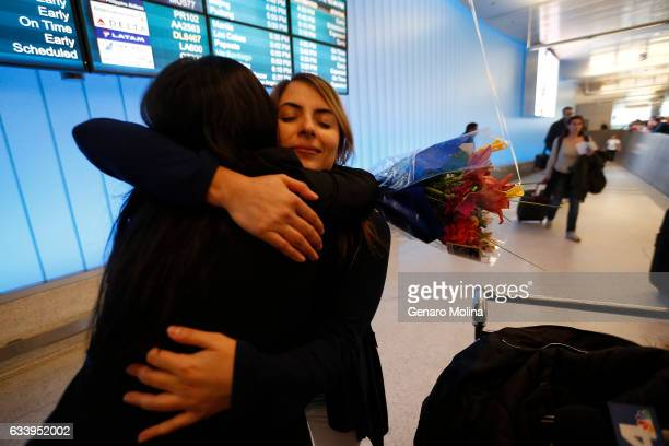 California student Sara Yarjani right is welcomed by her sister Sahar Muranovic after arriving at the Tom Bradley International Terminal at LAX on...