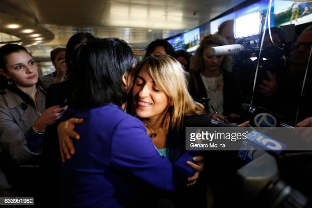 California student Sara Yarjani right receives a hug of support from Congresswoman Judy Chu in purple outfit after arriving at the Tom Bradley...