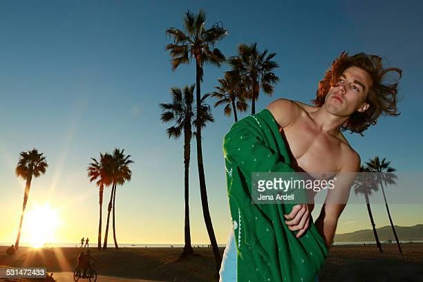 California surfer guy on beach at sunset