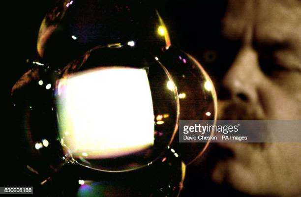 Californian bubbleblower Tom Noddy blows a square bubble and fills it with smoke to demonstrate the physics of inner surface structures as part of...