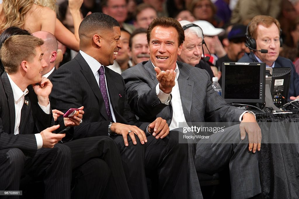 California's 38th Governor Arnold Schwarzenegger talks with Sacramento Mayor Kevin Johnson during the game between the Houston Rockets and the Sacramento Kings at Arco Arena on April 12, 2010 in Sacramento, California. The Rockets won 117-107.