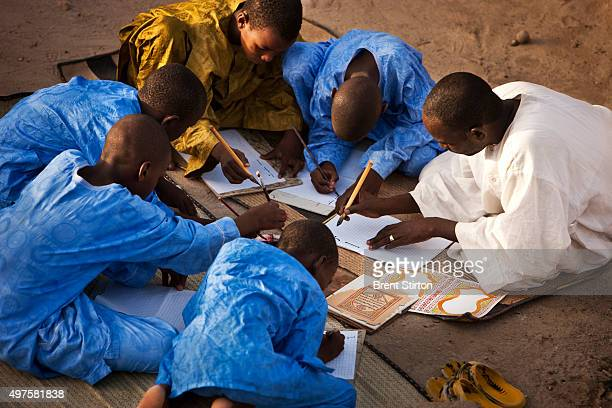 Caligrapher and Copyist Buboubacar Sadeck teaches students the art of ancient caligraphy on a Timbuktu rooftop September 8 2009 Timbuktu is a...
