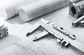 caliper and machine parts on mechanical blueprint