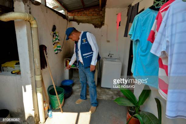 Cali's Secretary of Health Alexander Duran checks bowls at a house in Cali Colombia on February 17 2016 Cali's Health Secretariat massively delivered...