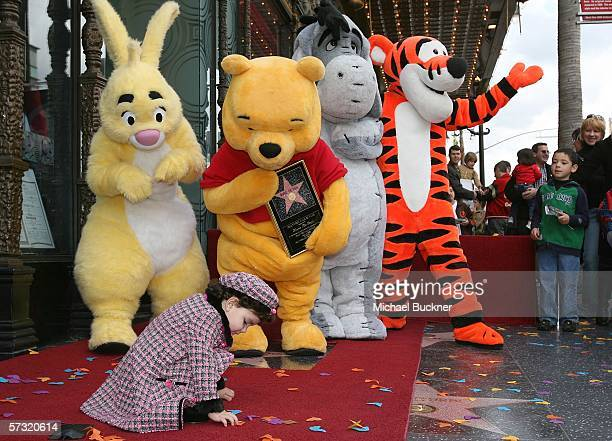 Calista Bess of San Dimas California plays on the carpet while Rabbit Winnie The Pooh Eeyore and Tigger pose for photographs celebrating Winnie The...