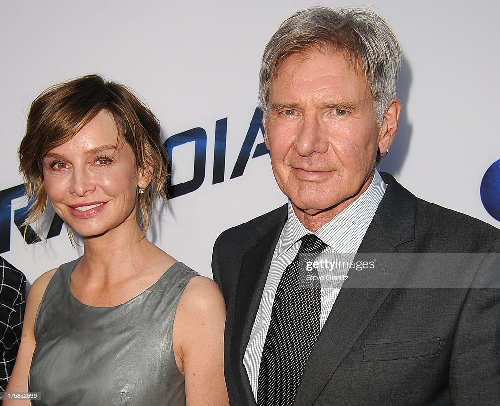 <a gi-track='captionPersonalityLinkClicked' href=/galleries/search?phrase=Calista+Flockhart&family=editorial&specificpeople=204604 ng-click='$event.stopPropagation()'>Calista Flockhart</a> and <a gi-track='captionPersonalityLinkClicked' href=/galleries/search?phrase=Harrison+Ford+-+Actor+-+Born+1942&family=editorial&specificpeople=11508906 ng-click='$event.stopPropagation()'>Harrison Ford</a> arrives at the 'Paranoia' - Los Angeles Premiere at DGA Theater on August 8, 2013 in Los Angeles, California.
