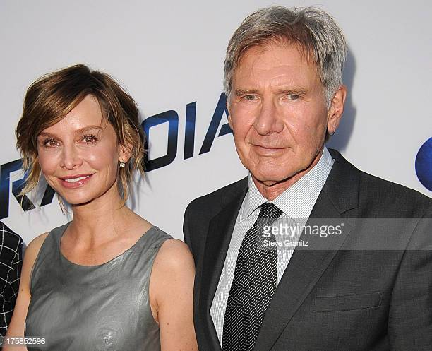 Calista Flockhart and Harrison Ford arrives at the 'Paranoia' Los Angeles Premiere at DGA Theater on August 8 2013 in Los Angeles California
