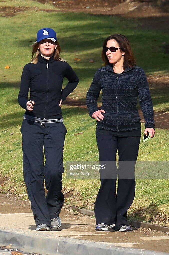 <a gi-track='captionPersonalityLinkClicked' href=/galleries/search?phrase=Calista+Flockhart&family=editorial&specificpeople=204604 ng-click='$event.stopPropagation()'>Calista Flockhart</a> is seen going for a walk with a friend on January 08, 2014 in Los Angeles, California.