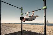 Man training calisthenics discipline in the city