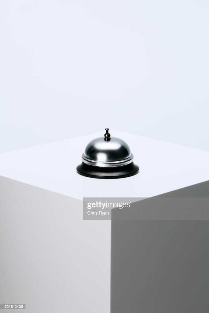 Call bell sitting on pedestal