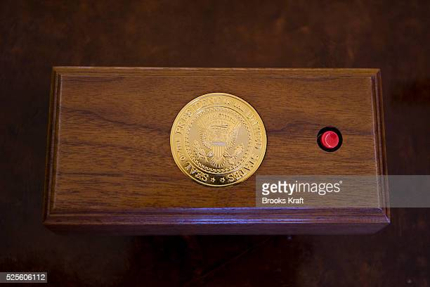 A call button for President Bush on his desk in the Oval Office when empty The Oval Office is the official office of the President of the United...
