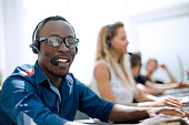 call center employee on the background of colleagues. photo with text space