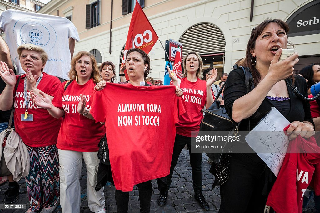Call center employees of Almaviva Contact Spa rally in Santi Apostoli Square to protest against the 3000 layoffs declared by Almaviva CEO Marco Tripi in Rome, Italy .