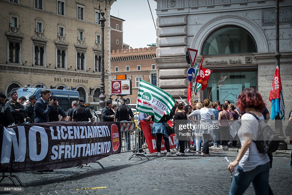 Call center employees of Almaviva Contact Spa rally in Santi Apostoli Square to protest against the 3000 layoffs declared by Almaviva CEO Marco Tripi in Rome, Italy.