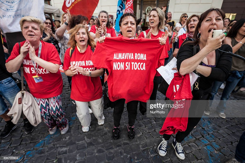 Call center employees of Almaviva Contact Spa take a rally in Santi Apostoli Square to protest against the 3000 layoffs declared by Almaviva CEO Marco Tripi in Rome, Italy, on May 27, 2016.